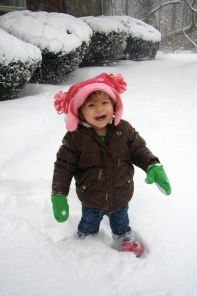 Samira grinning in the snow