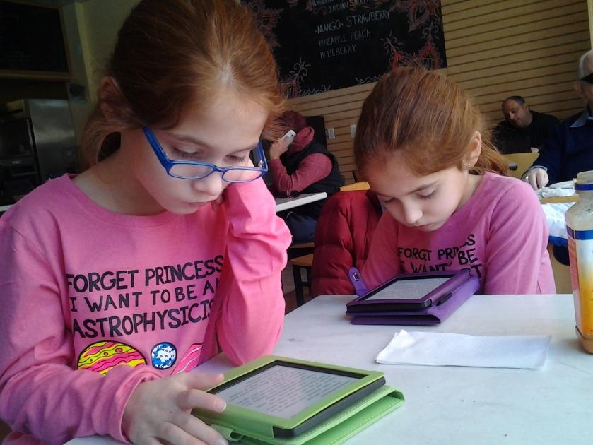 Kids enjoying Kindles